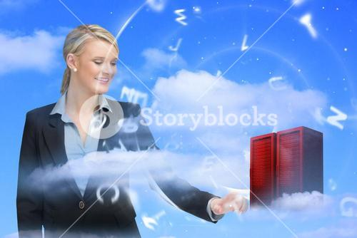Businesswoman touching data server tower