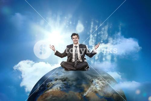 Businessman sitting on top of the world