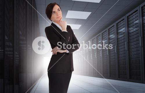 Businesswoman looking thoughtful in data center