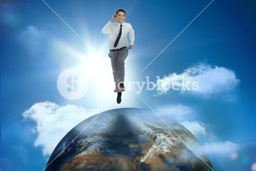 Businessman racing on top of the world