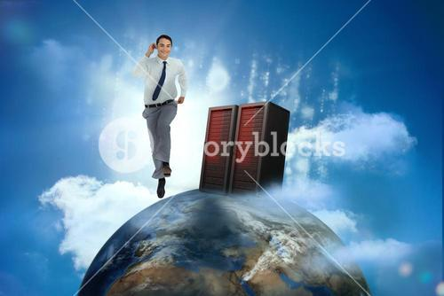 Businessman racing on top of the world beside server