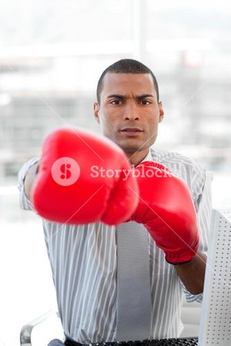 Super competitor businessman with boxing gloves