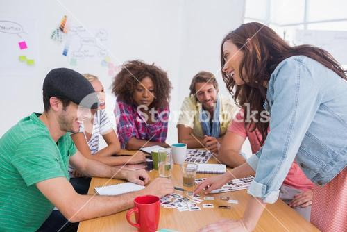 Editor picking photographs in a meeting