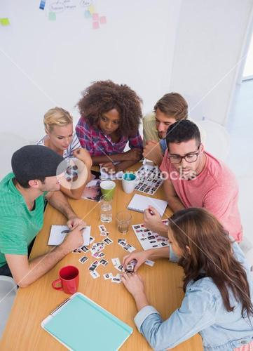 Editors choosing photographs in a meeting