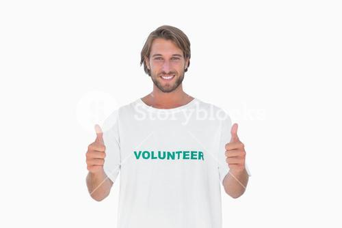 Happy man wearing volunteer tshirt giving thumbs up