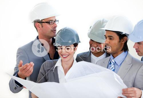 International engineers studying a construction plan