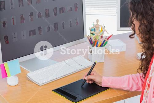 Editor using graphics tablet to edit
