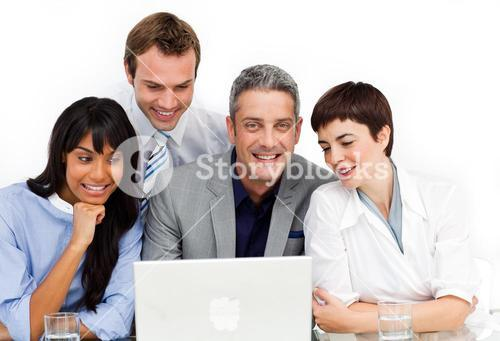 A diverse business group using a laptop