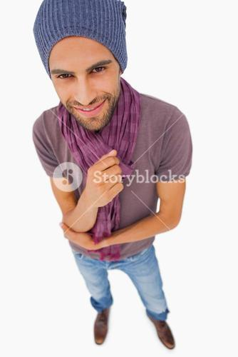 Happy man wearing beanie hat and scarf