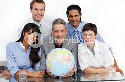 Confident business partners holding a globe