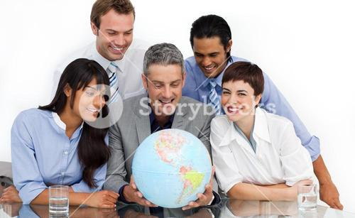 Smiling business partners holding a globe