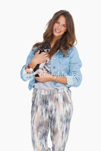 Happy woman with her puppy