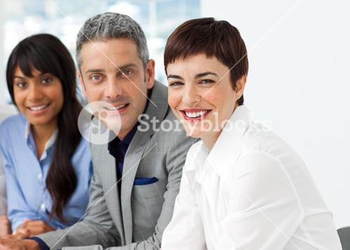 International business people sitting in a row