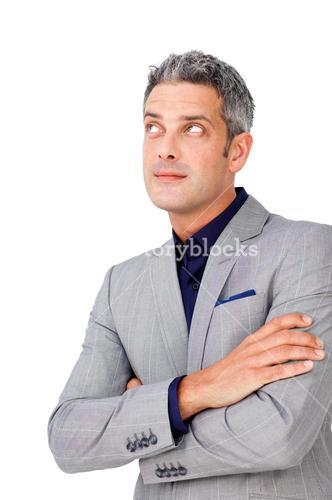 Businessman with folded arms looking up