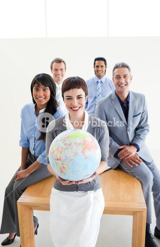 Business people holding a terrestrial globe