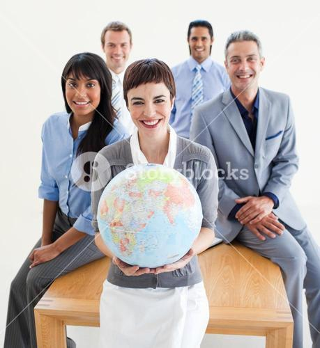 Cheerful business people holding a terrestrial globe
