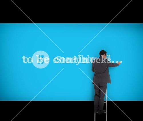 Businessman writing to be continued on a wall
