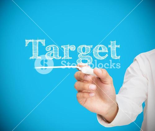 Businessman writing target with a chalk