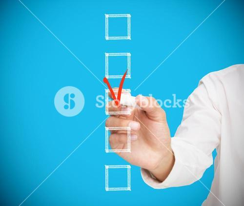 Businessman ticking a box in red