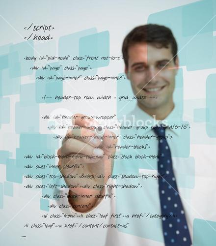 Smiling businessman writing sql language