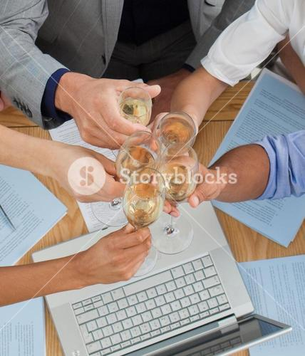Close up of a business team toasting with Champagne