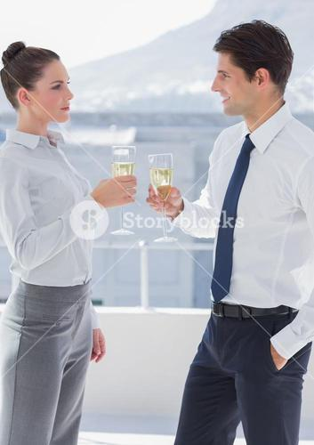 Business people clinking their flutes of champagne