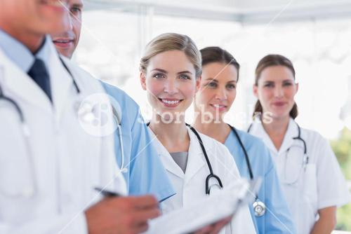 Smiling medical team in row