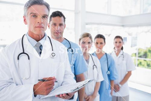 Serious medical team in row