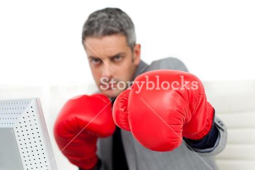 Selfassured businessman with boxing gloves