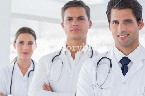 Three doctors with lab coats
