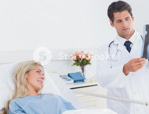 Attractive doctor showing xray
