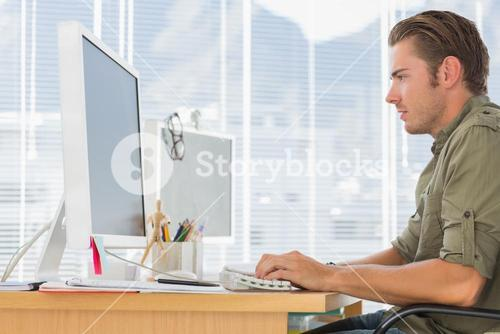Creative business employee working on computer