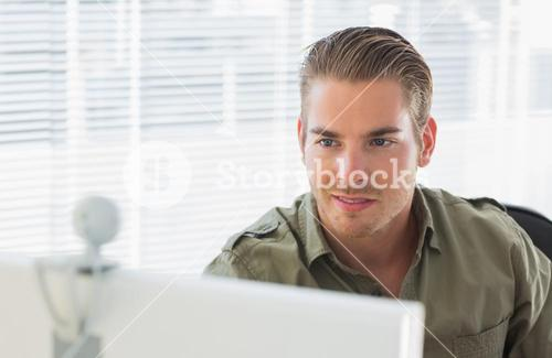 Creative business employee smiling during a videocall