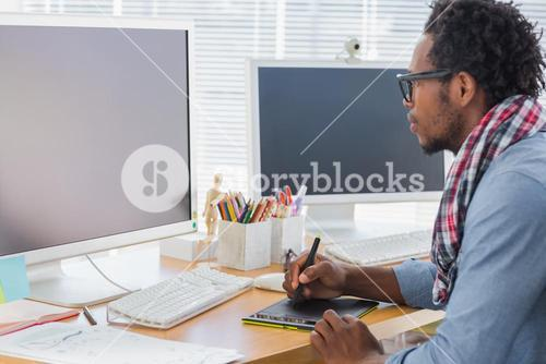 Graphic designer using a graphics tablet
