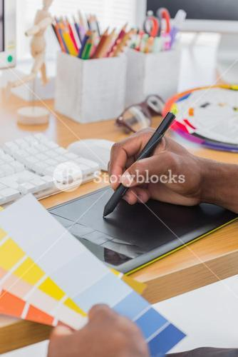 Interior designer with graphics tablet and colour chart