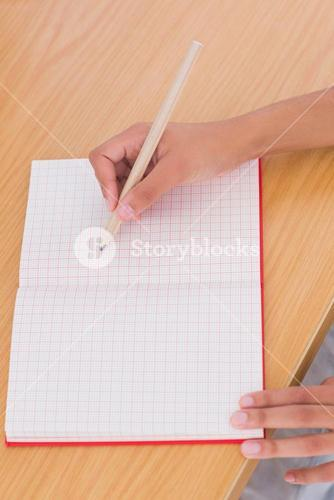Woman drawing on a paper with a pencil