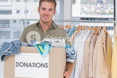 Handsome man holding donation box
