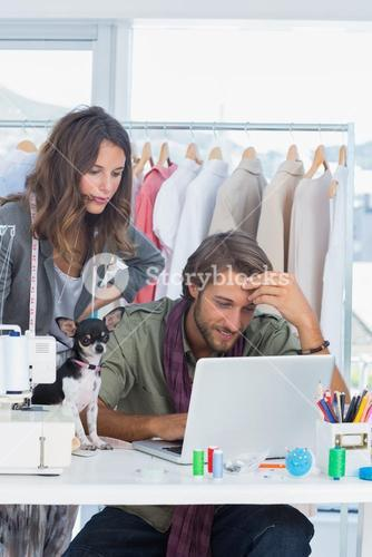 Fashion designers and little dog