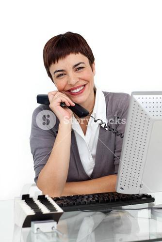 Enthusiastic businesswoman holding a telephone
