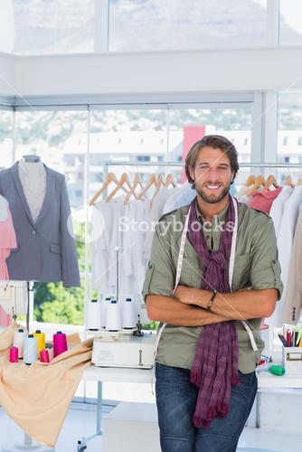 Fashion designer with arms crossed