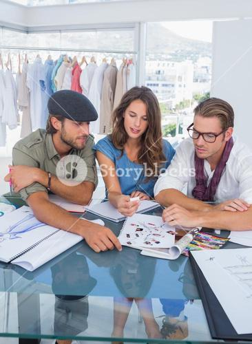 Three fashion designers during a brainstorming