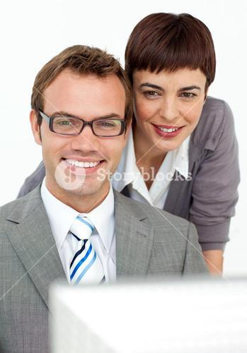 Businesswoman helping her colleague at a computer