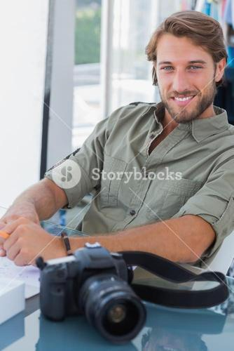Handsome photo editor smiling