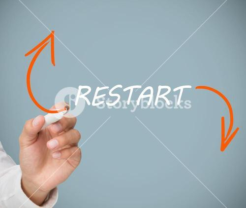 Businessman drawing orange arrows beside restart word