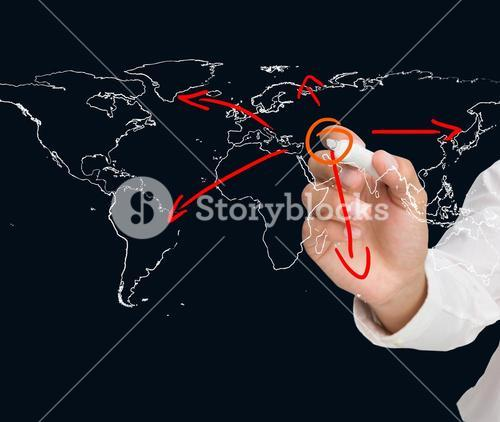 Businessman drawing world map with arrows