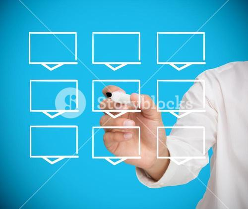 Businessman drawing a grid of white rectangles