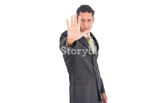 Businessman with raised hand