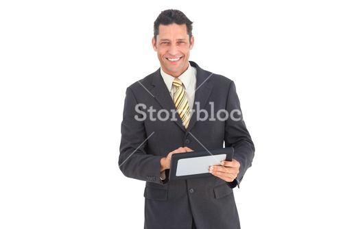 Smiling businessman with pc tablet