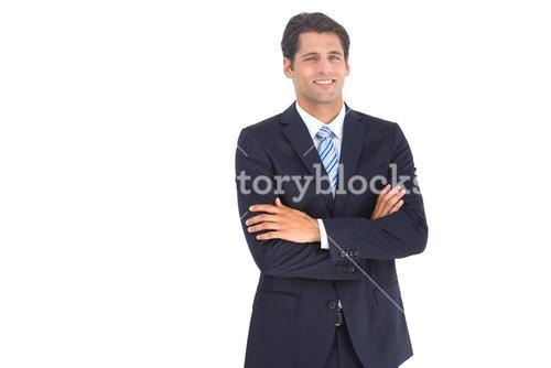 Stylish businessman with crossed arms