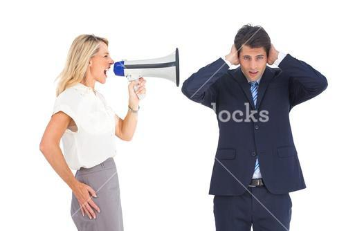 Businessman with hands on his ears because of megaphone